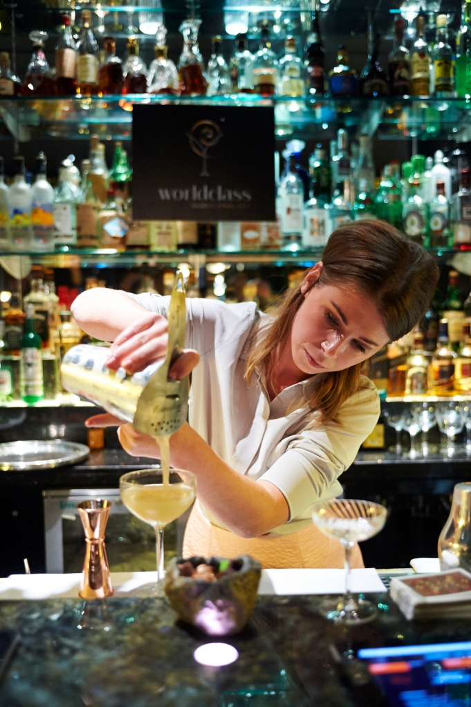 Hannah shaking it up behind the bar of the Savoy