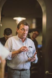 Patrick Van Schandevijl, Master Distiller at De Moor presenting a bottle of Lindemans Premium Gin